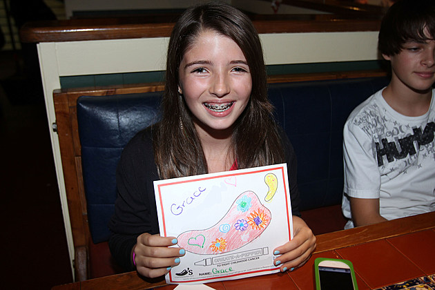 Joey King Participates As A VIP Server At Chili's In Auburn Hills, Michigan